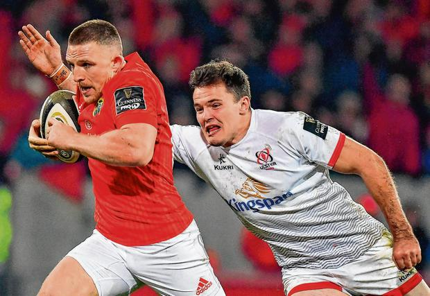 Decisive display: Munster's Andrew Conway breaks past Ulster's Jacob Stockdale on his way to scoring the winning try in Saturday night's PRO14 clash at Thomond Park. Photo: Brendan Moran/Sportsfile