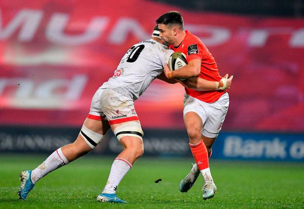 Conor Murray of Munster is tackled by Matthew Rea of Ulster. Photo: Brendan Moran/Sportsfile