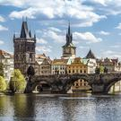 A view of Charles Bridge and the Old Town of Prague, including the Old Town City Hall