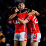 East Kerry players Darragh Roche (left) and Padraig De Brún (right) embrace David Clifford as they celebrate at the final whistle in Tralee yesterday. Photo: Brendan Moran/Sportsfile