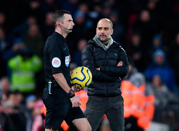 Pep Guardiola, Manager of Manchester City stares at referee Michael Oliver as he walks onto the pitch for the second half. Photo: Laurence Griffiths/Getty Images