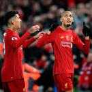 Liverpool's Fabinho (right) celebrates scoring his side's first goal