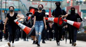Clashes: Protesters prepare a barricade in Hong Kong. Photo: REUTERS/Thomas Peter