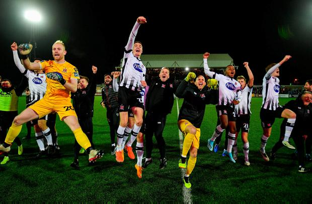 Dundalk players celebrate after winning the Unite the Union Champions Cup over Linfield at Oriel Park. Photo: Eóin Noonan/Sportsfile