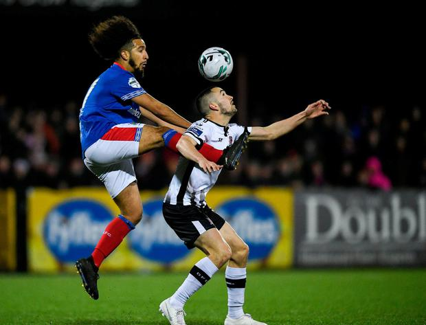 Michael Duffy controls the ball under pressure from Linfield's Bastien Héry. Photo: Eóin Noonan/Sportsfile