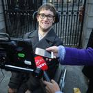 Liberating: Connor Corroon speaking to the media through a computer aid outside the Four Courts yesterday after his High Court action. Photo: Collins Courts