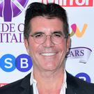 Simon Cowell will launch X Factor: The Band to find all-male and all-female groups (Ian West/PA)