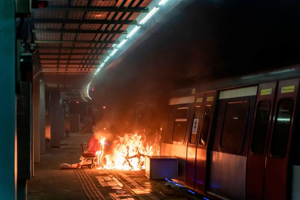 A fire is seen at a MTR station during a demonstration at Chinese University of Hong Kong on November 13, 2019 in Hong Kong, China. Photo by Anthony Kwan/Getty Images