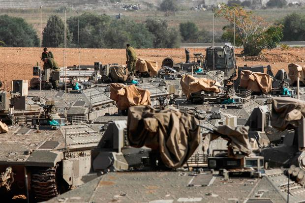 Border force: Israeli armoured vehicles stationed near the border with the Gaza Strip. Photo: Getty Images