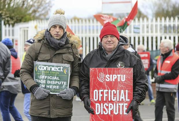 James Daly and Brian Keating with fellow staff members on the picketline outside the SK Biotek plant in Swords Picture; Gerry Mooney