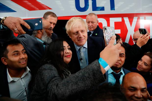 Tortuous journey: Boris Johnson at the unveiling of the Conservative Party general election campaign bus in Manchester, but it remains far from clear what the ultimate destination will be after the UK exits the EU. Photo: Frank Augstein/AFP