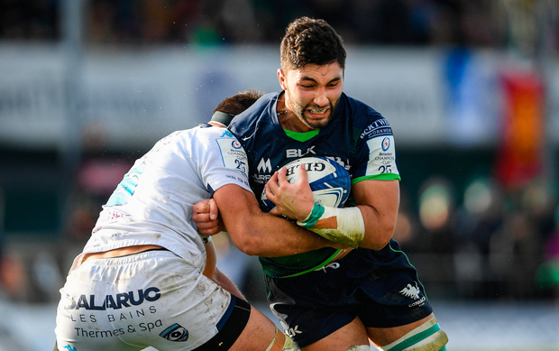 Colby Faingaa of Connacht is tackled by Paul Willemse of Montpellier. Photo by Ramsey Cardy/Sportsfile