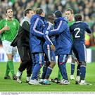 14 November 2009; Richard Dunne, right, Republic of Ireland, with French players at the end of the game. FIFA 2010 World Cup Qualifying Play-off 1st Leg, Republic of Ireland v France, Croke Park, Dublin. Picture credit: David Maher / SPORTSFILE