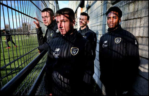 Dylan O'Neill, Jamie Redmond, Kevin Kelly and Davidson Okosun look on at training. Photo: Steve Humphreys