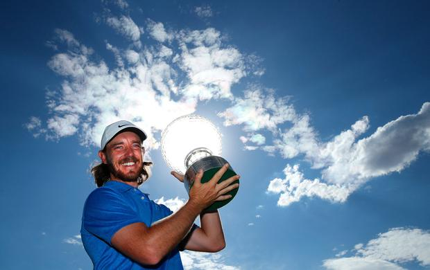 Tommy Fleetwood celebrates with the trophy after his victory at the Nedbank Golf Challenge. Photo: Warren Little/Getty Images
