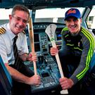 Kilkenny hurler Eoin Murphy pictured alongside Aer Lingus Captain Brian O'Sullivan prior to their departure to New York where they won the inaugural New York Hurling Classic. Photo: Brendan Moran/Sportsfile