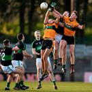 Alan O'Donovan of Nemo Rangers contests a high ball with Austin Stacks pair Michael O'Donnell (left) and Joseph O'Connor in yesterday's Munster Club SFC semi-final at Páirc Uí Rinn. Photo: Eóin Noonan/Sportsfile