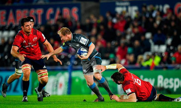 Ospreys' Luke Price is stopped in his tracks by Jean Kleyn, left, and Peter O'Mahony. Photo: Seb Daly/Sportsfile