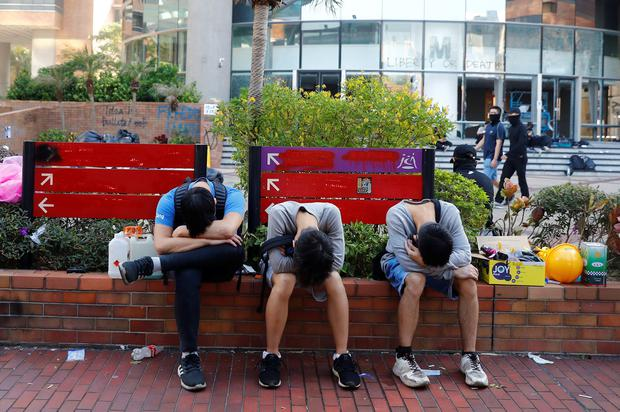 Protesters rest on the campus of Hong Kong Polytechnic University (PolyU) after clashes with police in Hong Kong, China November 18, 2019. REUTERS/Thomas Peter