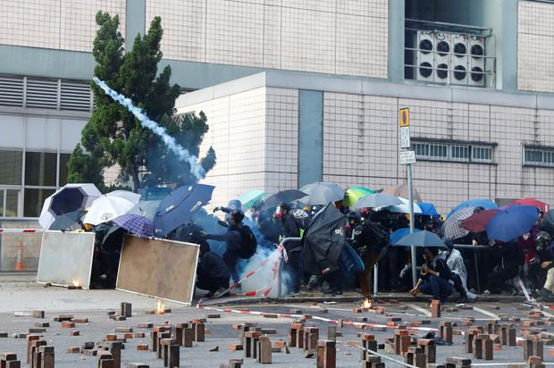Protesters clash with riot police as they try to leave the surrounded campus of Hong Kong Polytechnic University (PolyU), in Hong Kong, China November 18, 2019. REUTERS/Thomas Peter