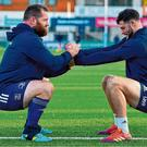 Michael Bent, left, and Robbie Henshaw get a good stretch in during Leinster training at Energia Park in Donnybrook. Photo: Brendan Moran/Sportsfile
