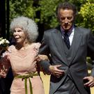 Spain's Duchess of Alba, Maria del Rosario Cayetana Fitz-James-Stuart and her husband Alfonso Diez walk towards photographers after their wedding ceremony at the Palacio de las Duenas on October 5, 2011 in Seville, Spain. (Photo by Daniel Perez/Getty Images)