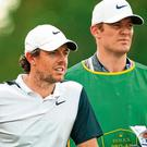 Rory McIlroy assesses his options during a Dubai practice round alongside stand-in caddie Niall O'Connor, a former rugby player with Connacht and Ulster. Photo: Ross Kinnaird/Getty Images