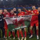 Gareth Bale is pictured with his team-mates holding up a Welsh flag which hasn't gone down well in Spain