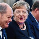 German finance minister Olaf Scholz, seen here talking with chancellor Angela Merkel, has called for action on banking union projects. Photo: Annegret Hilse/Reuters
