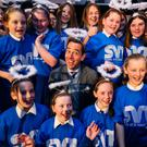 Spreading message: Ryan Tubridy with the choir from St Joseph's school, Tipperary town, at the launch of the SVP appeal. Photo: Brian Lawless/PA Wire