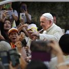 Pope Francis waves to a crowd standing hours to greet him at the Saint Louis Hospital in Bangkok, Thailand (Photo: Manish Swarup/AP)