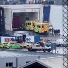 Emergency personnel at Rosslare Europort in Co Wexford, board the Stena Line ferry after 16 people were discovered in a sealed trailer on the ship sailing from France. Niall Carson/PA Wire