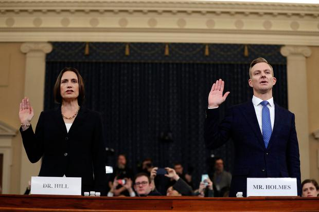 Oath: Former national security aide Fiona Hill and David Holmes, a US diplomat in Ukraine, are sworn in on Capitol Hill yesterday. PHOTO: AP
