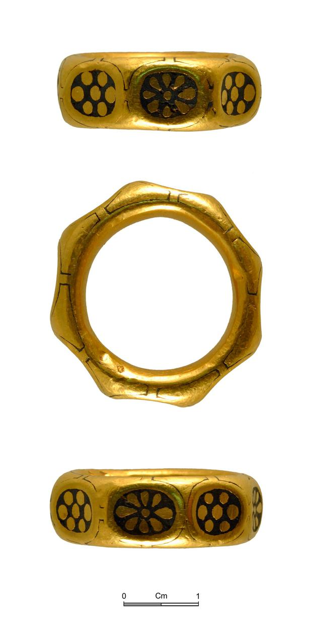 Photo issued by the British Museum of a gold ring from the ninth century which was part of a £3 million Viking hoard, metal detectorists George Powell and Layton Davies have been convicted of stealing the hoard after they found it buried in the ground on Herefordshire farmland and didn't tell the authorities, the land-owner, or the Crown. photo British Museum/PA Wire