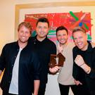 Westlife celebrate their Official Number 1 Album Award from the Official Charts Company for Spectrum. Photo: OfficialCharts.com/PA Wire