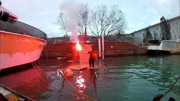 Gone: Daryl Smith stands with a flare where his boat was destroyed