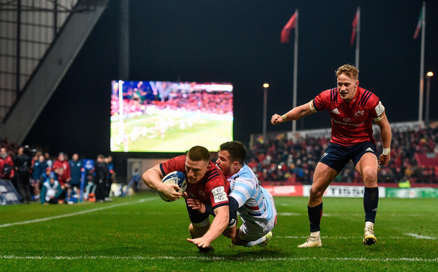 Andrew Conway of Munster goes over to score his side's third try despite the efforts of Brice Dulin of Racing 92 during the Heineken Champions Cup Pool 4 Round 2 match between Munster and Racing 92 at Thomond Park in Limerick. Photo by Sam Barnes/Sportsfile