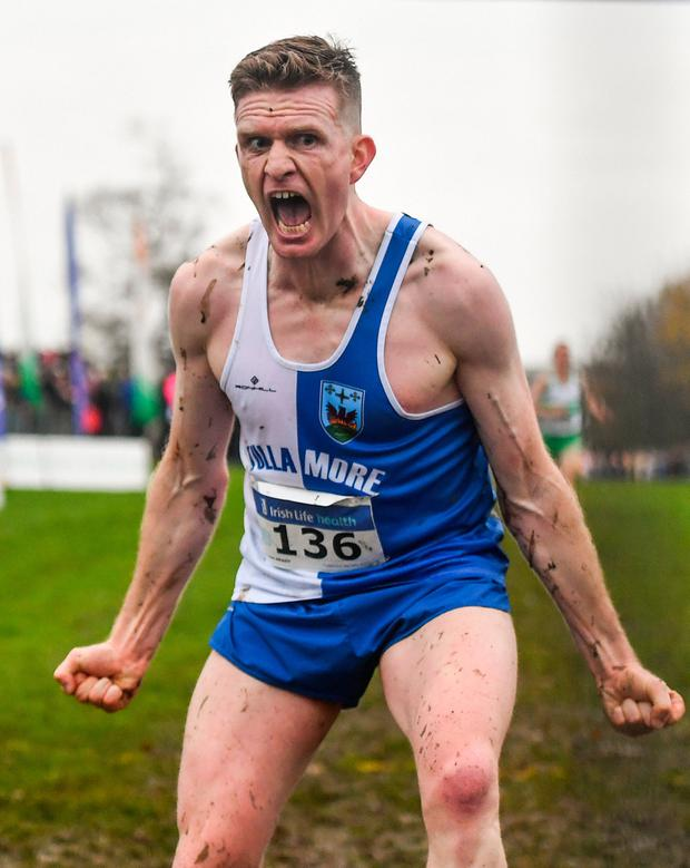 Liam Brady of Tullamore Harriers A.C., Co. Offaly, celebrates winning the Senior Men's event. Photo by Sam Barnes/Sportsfile