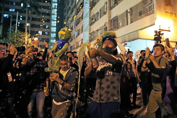 Pro-democracy supporters celebrate in Hong Kong (AP Photo/Kin Cheung)