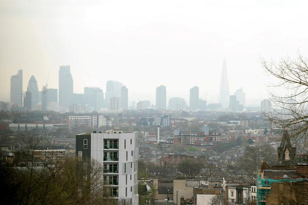 File photo of the City of London skyline as seen through a layer of smog. Photo: Yui Mok/PA Wire