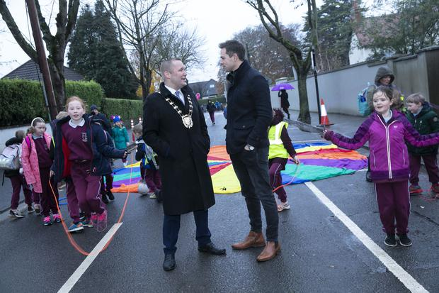 Mayor of Fingal Eoghan O'Brien and GAA player Dean Rock with children from St Oliver Plunkett's on the section of closed road on Grove Road. Pic Orla Murray/ SON Photo