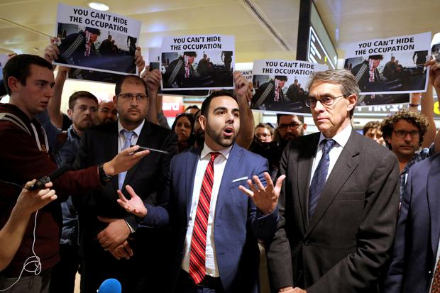 Omar Shakir, a U.S. citizen representing New York-based Human Rights Watch (HRW) in Israel and the Palestinian territories, stands next to Kenneth Roth executive director of HRW, while speaking before departing Israel at Ben Gurion International Airport, near Tel Aviv, Israel November 25, 2019. Picture: REUTERS/Ammar Awad