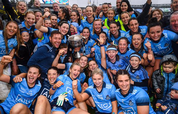 QUEENS OF IRELAND: Dublin players celebrate with the Brendan Martin Cup following the TG4 All-Ireland Ladies Football Senior Championship Final at Croke Park in September. Photo: Stephen McCarthy/Sportsfile