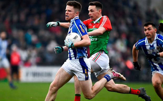 HANDS OFF: Robbie McDaid of Ballyboden St Endas shakes off the challenge of Garrycastle's Mark McCallon at Cusack Park. Photo: Ray McManus/Sportsfile
