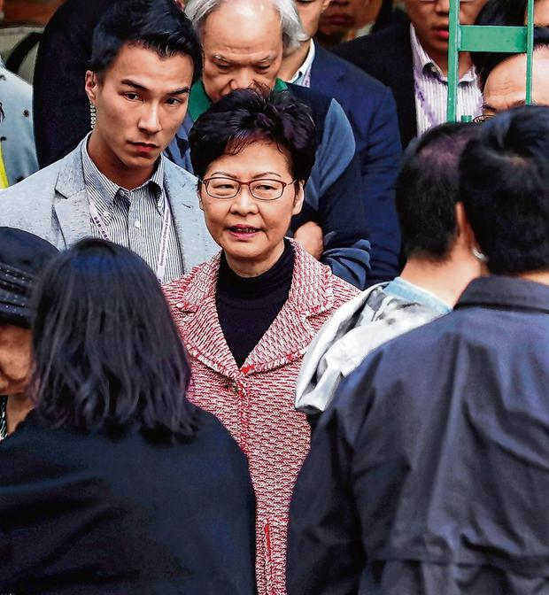 Under pressure: Carrie Lam, Hong Kong's pro-Beijing leader, after voting in the city's local council elections. Photo: Athit Perawongmetha/Reuters