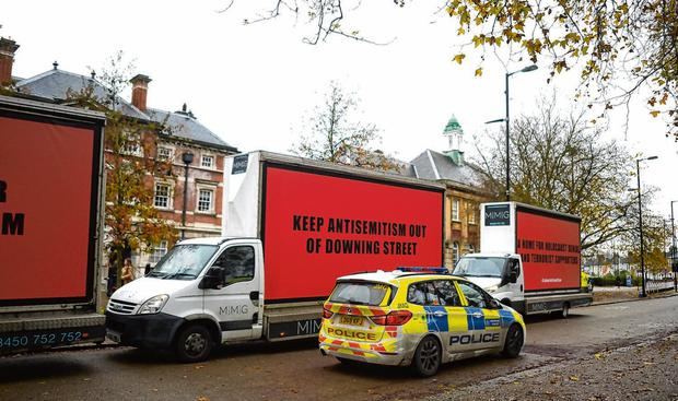 Protest: Poster trucks were in place to greet Mr Corbyn when he arrived in Tottenham, London yesterday. Photo: Peter Summers/Getty Images
