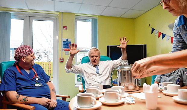 Hospital call: Boris Johnson has tea with staff members as he visits West Cornwall Community Hospital in Penzance yesterday. Photo: Stefan Rousseau/PA Wire