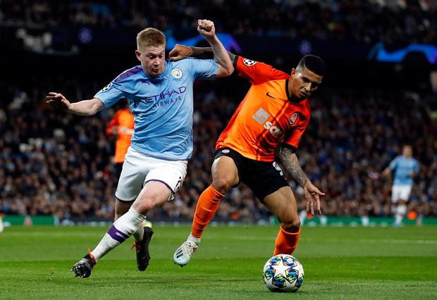 In demand: Manchester City's Kevin De Bruyne (left) and Shakhtar Donetsk's Dodo battle for the ball. Photo: PA