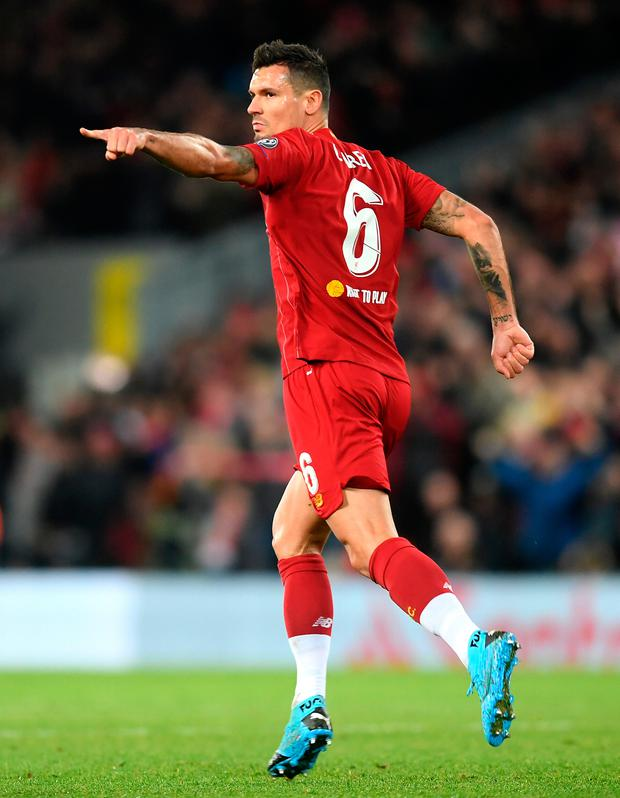Pointing the way: Liverpool's goalscorer Dejan Lovren wheels away to celebrate after heading home an equaliser in last night's Champions League Group E clash against Napoli at Anfield, which ended in a 1-1 draw. Photo: Getty Images