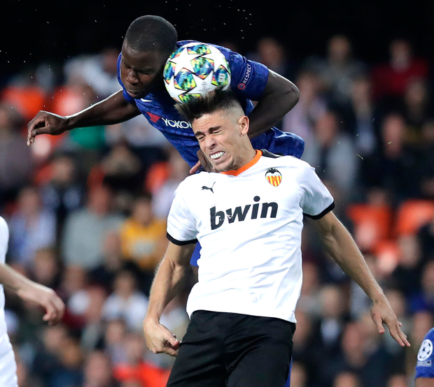Chelsea's Kurt Zouma and Valencia's Gabriel Paulista rise for the ball. Photo: Getty Images